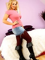 Busty blonde in sexy denim miniskirt and purple pantyhose