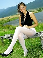 Breathtaking brunette in black top, white miniskirt and white pantyhose