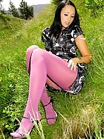 Dark haired beauty in a sexy evening dress and pink pantyhose