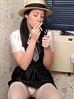 Naughty UK schoolgirl smokes and rubs clit on a WC pan