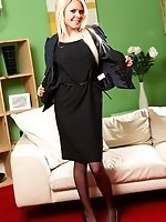 Theo in a smart, black dress, pantyhose and heels. Perfect!