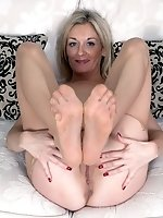 Playful milf rips her suntan tights and boasts her nyloned feet